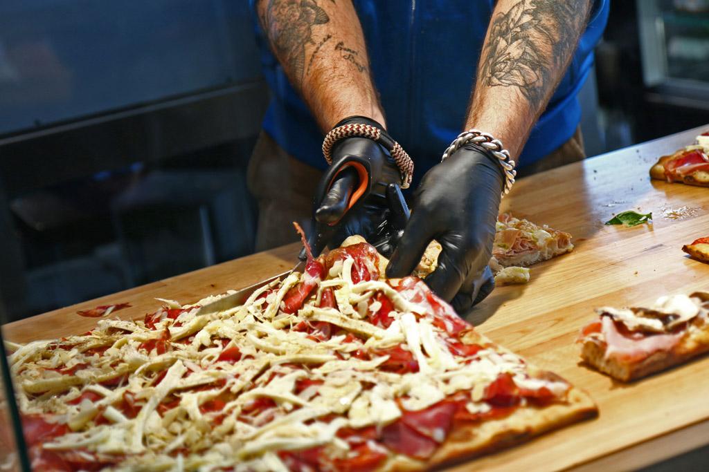 Les pizzas au mètre et au poids